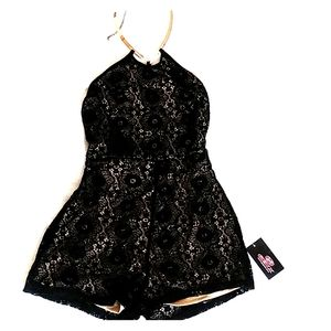 Lace Romper with metal choker.